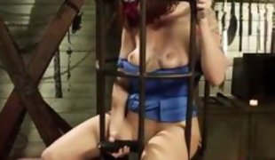 caged redhead slut gets teased by blonde mistress