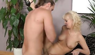 Stunning blonde gilf Merylin is riding