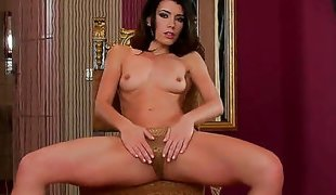 Brunette Betty Saint playing with sex toy