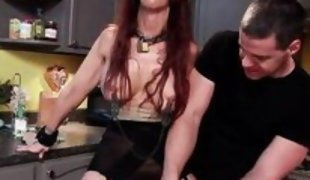 redhead whore mouth gagged in the kitchen